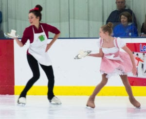 "At right, Emily, 15, skating with Taylor, 16, to the song, ""Hot Chocolate,"" from The Polar Express."